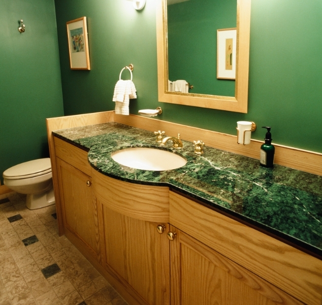 Green marble countertop with ash vanity suburban Boston.