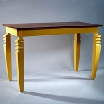 New York apartment dining table in teak with painted base.
